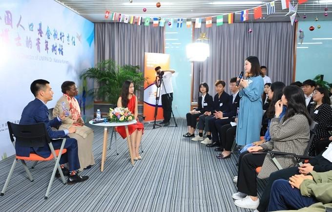 A youth representative sharing her story with Dr. Natalia Kanem on her participation in the UNFPA Leadership Project in Beijing on 25 April 2019. Photo credit: BIEG
